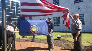 Pickens County deputies led by Lt. Tyrone Duke are seen raising the flag at the Vietnam 50th Commemoration ceremony. (Photo by Beth Finley)