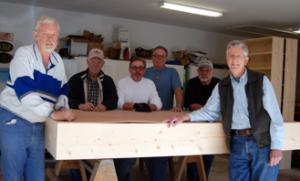 Club members Cecil Schneider, John Mann, Ken Kidd, Grant Grimes, Kevin White and Bob Burton assembled shelving for the Good Sam pharmacy project.