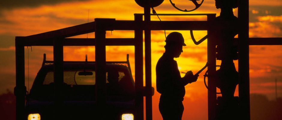 Photographer Mark Green captures an oil field worker in South Texas at sunrise, 1990.