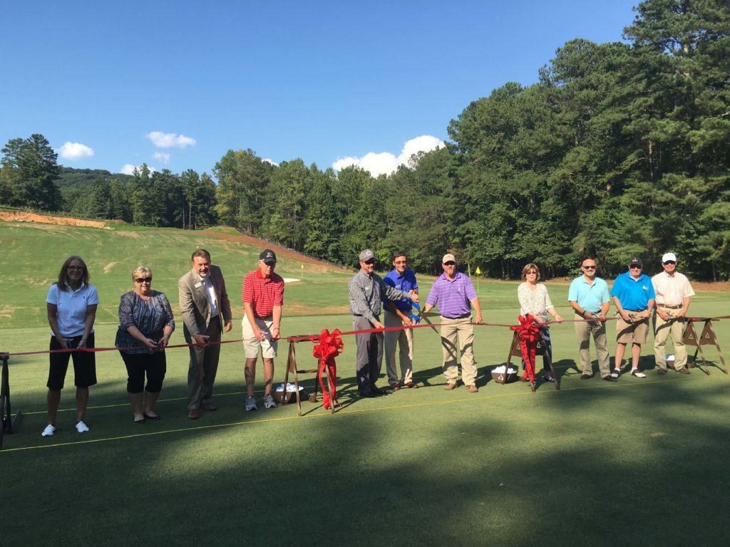 It was a great day for Big Canoe golfers when the ribbon was cut to open the new driving range. (Photo by Golf Shop Staff)