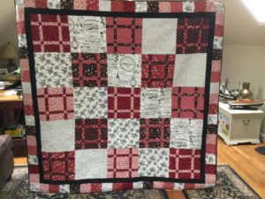 You can win this beautiful quilt created by the Pine Needle Quilters! (Photo by Kay Stanley)
