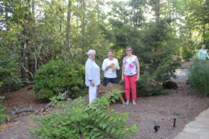 Dolly Blake (right) introduces her beautiful garden to Lauren Grant and Jane Clay. (Photo by Fran Holman)