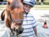 Students learn to ride and care for a horse at Angels on Horseback.  (Photo by David Akoubian)