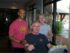 Fitness trainer Terence Griggs (left) poses with star pupil Phil Deal and his wife Kathy. The NuStep Cross Trainer is an important part of Phil's rehab plan. (Photo by Steve Panetta)