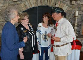 """""""Sequoyah"""" explaining the Cherokee syllabary to Sequoyah DAR members (l-r) Vice Regent Echo Hopkins, Regent Beth Finley, and American Indian co-chair Cricket Travers."""