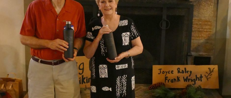 Joyce Raley and Frank Wright recently passed the official club water bottles to a new team ready and willing to lead Big Canoe Hikers to new adventures. (Photo by Steve Papke)
