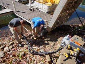 It's a good thing warm weather marked the days so work could be done on the docks. (Photo by Big Canoe Marina staff)