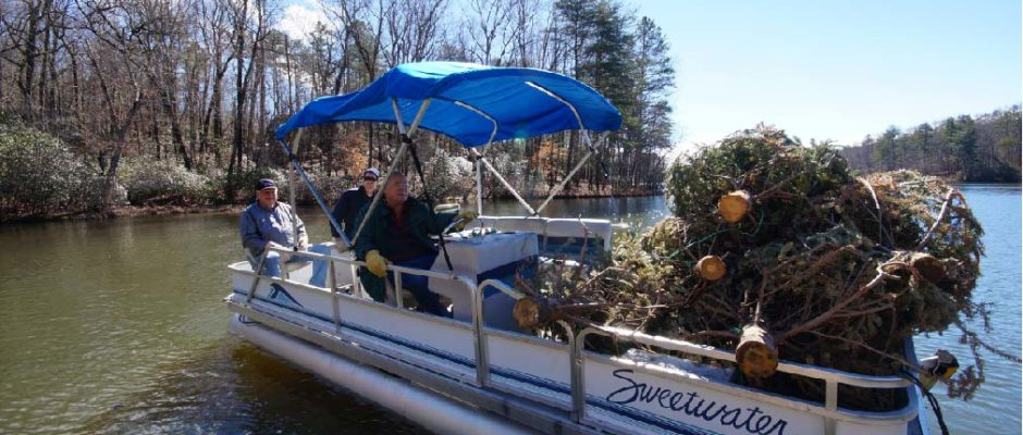Heading out to sea with a load of green. Christmas trees are bundled together by Big Canoe Marina volunteers to make a reef playground for fish. (Photo by Big Canoe Marina staff)